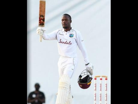 West Indies batsman Nkrumah Bonner celebrates his maiden Test century on the final day of their first Test match against Sri Lanka at the Sir Vivian Richards Stadium in St John's, Antigua, on Thursday, March 25.