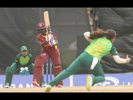 Rashada Williams (centre) of the West Indies Women's team in action against South Africa in the third One Day International at the Coolidge Ground in Antigua yesterday.