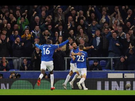 Everton's Andros Townsend (centre) celebrates scoring his side's second goal during their English Premier League match against Burnley at Goodison Park, Liverpool, England on Monday. Everton won 3-1.