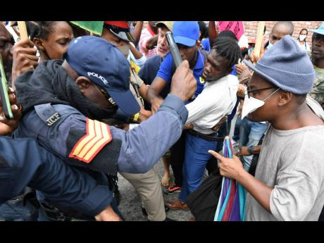 Protestors grapple with police during the march.